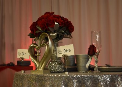 Red Flowers on Sweetheart Table at Vow Renewal Reception