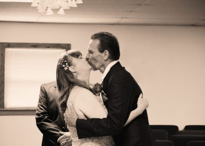 Bride & Groom Kiss at end of 25th Anniversary Vow Renewal
